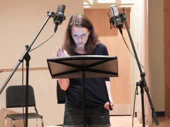 "Kira Lace Hawkins making vocal art while recording ""Three Days."" (Photo by Clayton Marcum)"
